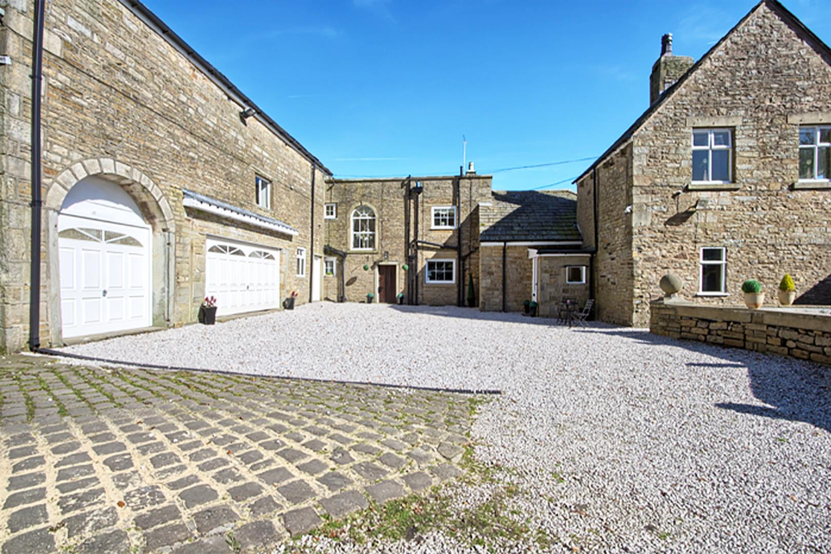 4 bedroom house For Sale in Bolton - courtyard.png.